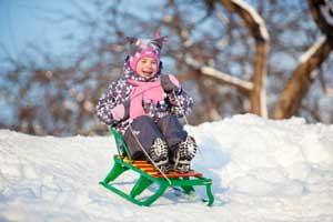 Photo child on a sled